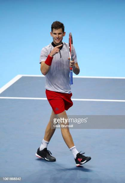 Dominic Thiem of Austria celebrates match point after he wins his round robin match against Kei Nishikori of Japan during Day Five of the Nitto ATP...