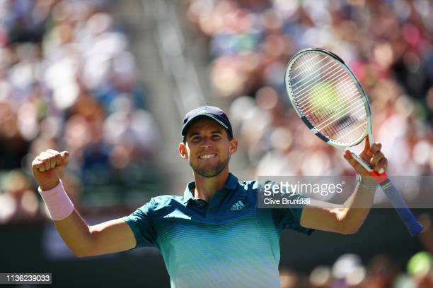 Dominic Thiem of Austria celebrates match point against Milos Raonic of Canada during their men's singles semifinal match on day thirteen of the BNP...