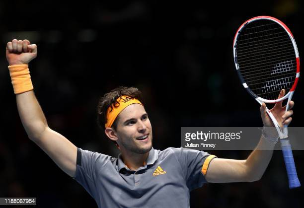 Dominic Thiem of Austria celebrates match point in his semifinal singles match against Alexander Zverev of Germany during Day Seven of the Nitto ATP...