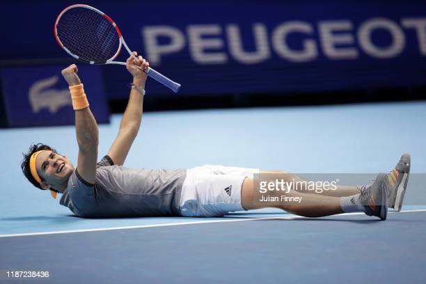 Dominic Thiem of Austria celebrates match point in his singles match against Novak Djokovic of Serbia during Day Three of the Nitto ATP Finals at The...