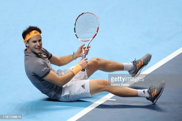 Dominic Thiem of Austria celebrates match point in his singles match against Novak Djokovic of Serbia during Day Three of the Nitto ATP World Tour...