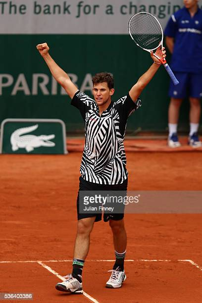Dominic Thiem of Austria celebrates victory during the Men's Singles fourth round match against Marcel Granollers of France on day eleven of the 2016...