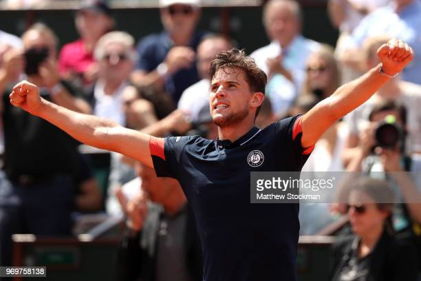 Dominic Thiem of Austria celebrates victory during the mens singles semifinal match against Marco Cecchinato of Italy during day thirteen of the 2018...