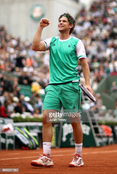 Dominic Thiem of Austria celebrates victory following the mens singles quarter finals match against Novak Djokovic of Serbia on day eleven of the...