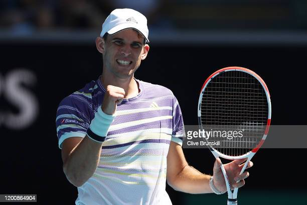 Dominic Thiem of Austria celebrates winning match point during his Men's Singles first round match against Adrian Mannarino of France on day two of...