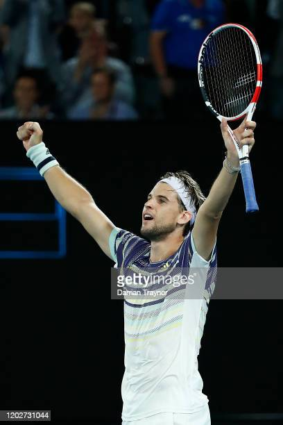 Dominic Thiem of Austria celebrates winning match point during his Men's Singles Quarterfinal match against Rafael Nadal of Spain on day ten of the...