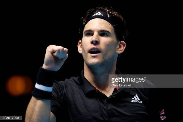 Dominic Thiem of Austria celebrates winning match point during his singles match against Rafael Nadal of Spain during day three of the Nitto ATP...