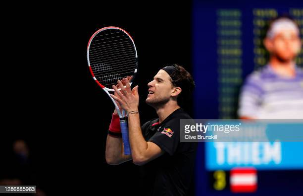 Dominic Thiem of Austria celebrates winning match point during his singles semi final match against Novak Djokovic of Serbia during day seven of the...