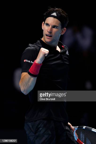 Dominic Thiem of Austria celebrates winning the first set during his singles match against Rafael Nadal of Spain during day three of the Nitto ATP...