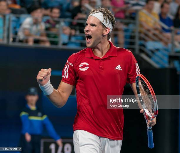 Dominic Thiem of Austria celebrates winning the match point during his Group E singles match against Diego Schwartzman of Argentina during day four...