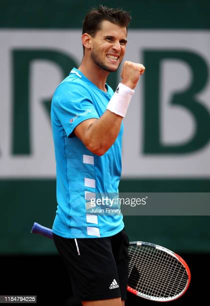 Dominic Thiem of Austria celebrates winning the second set during the mens singles final against Rafael Nadal of Spain during Day fifteen of the 2019...