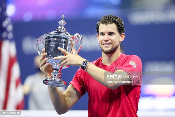 Dominic Thiem of Austria celebrates with championship trophy after winning in a tiebreaker during his Men's Singles final match against Alexander...