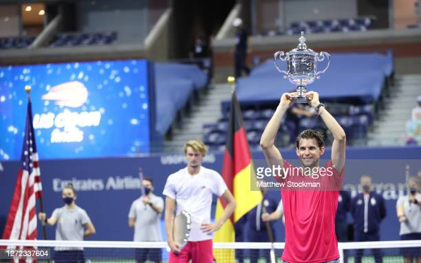 Dominic Thiem of Austria celebrates with championship trophy after winning in a tie-breaker during his Men's Singles final match against Alexander...