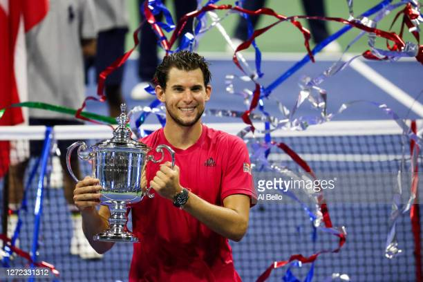 Dominic Thiem of Austria celebrates with the championship trophy after winning in a tie-breaker during his Men's Singles final match against...