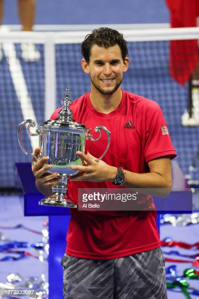 Dominic Thiem of Austria celebrates with the championship trophy after winning in a tiebreaker during his Men's Singles final match against Alexander...