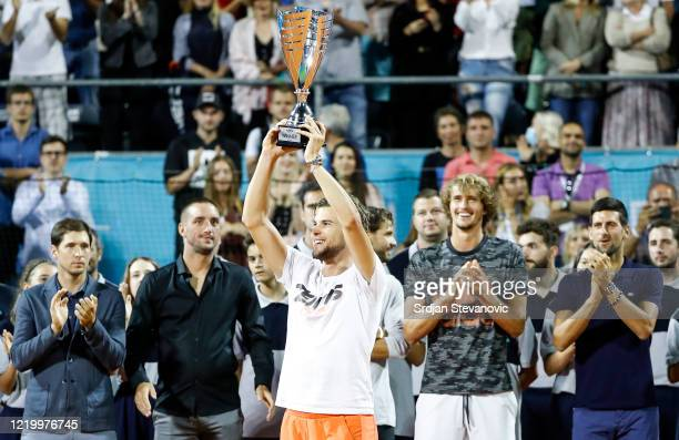 Dominic Thiem of Austria celebrates with the trophy after winning his final match against Filip Krajinovic of Serbia at the Adria Tour charity...