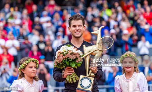 Dominic Thiem of Austria celebrates with the trophy after winning against Albert RamosVinolas of Spain in the singles final match of the Generali...
