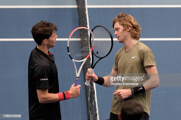 Dominic Thiem of Austria congratulates Andrey Rublev of Russia for winning the quarter finals match on day seven of the Erste Bank Open tennis...