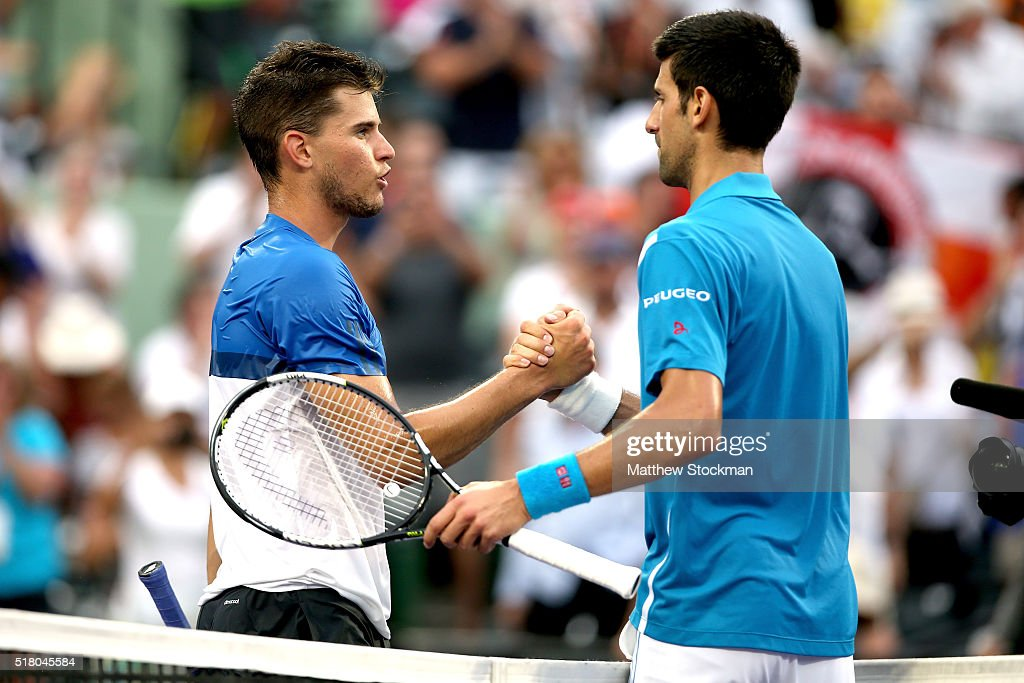 Dominic Thiem of Austria congratulates Novak Djokovic of Serbia after their match during the Miami Open presented by Itau at Crandon Park Tennis Center on March 29, 2016 in Key Biscayne, Florida.