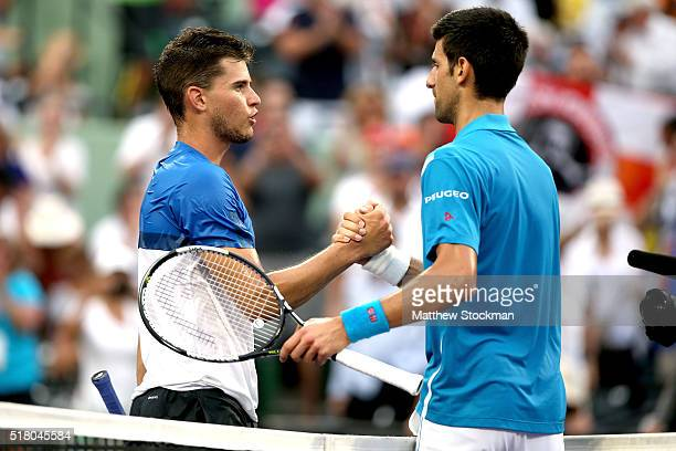 Dominic Thiem of Austria congratulates Novak Djokovic of Serbia after their match during the Miami Open presented by Itau at Crandon Park Tennis...