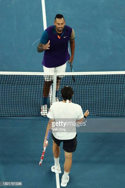 Dominic Thiem of Austria embraces Nick Kyrgios of Australia after winning the Men's Singles third round match during day five of the 2021 Australian...