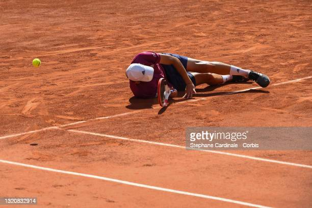 Dominic Thiem of Austria falls down in his First Round match against Pablo Andujar of Spain during Day One of the 2021 French Open at Roland Garros...