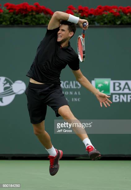 Dominic Thiem of Austria follows through on a forehand to Stefanos Tsitsipas of Greece during the BNP Paribas Open on March 10 2018 at the Indian...
