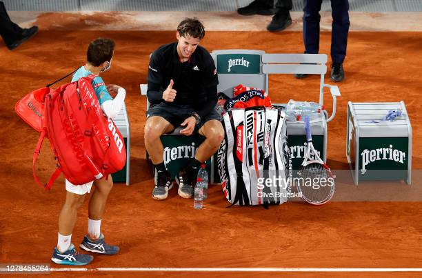 Dominic Thiem of Austria gives a thumbs up to Hugo Gaston of France as he walks off the court following their Men's Singles fourth round match on day...