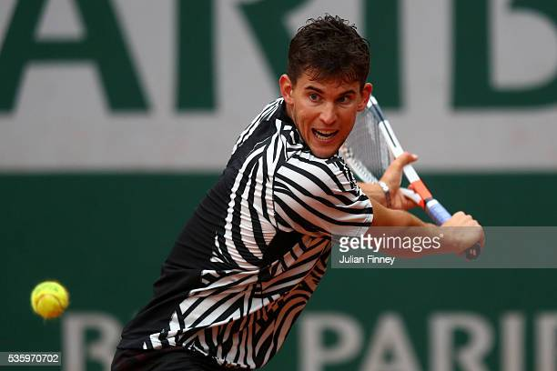Dominic Thiem of Austria hits a backhand during the Men's Singles fourth round match against Marcel Granollers of France on day ten of the 2016...