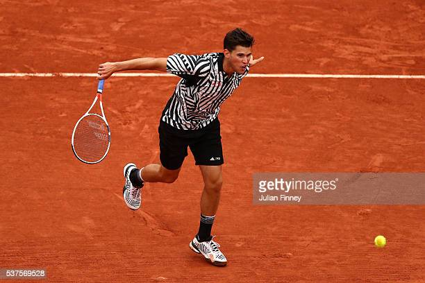 Dominic Thiem of Austria hits a backhand during the Men's Singles quarter final match against David Goffin of Belgium on day twelve of the 2016...