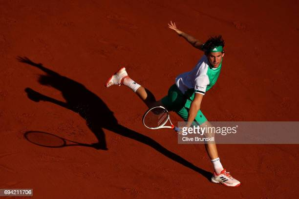 Dominic Thiem of Austria hits a backhand during the men's singles semi final match against Rafael Nadal of Spain on day thirteen of the 2017 French...