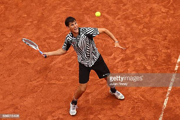 Dominic Thiem of Austria hits a forehand during the Men's Singles fourth round match against Marcel Granollers of France on day ten of the 2016...