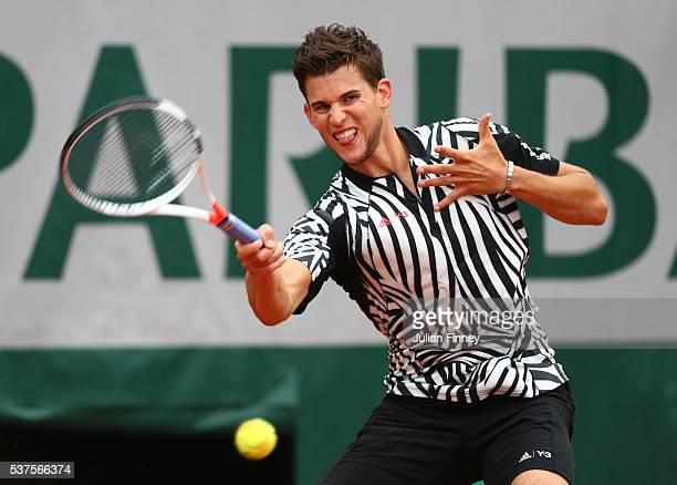 Dominic Thiem of Austria hits a forehand during the Men's Singles quarter final match against David Goffin of Belgium on day twelve of the 2016...