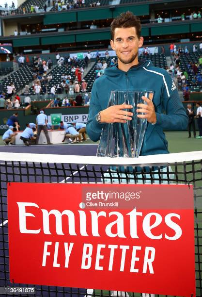 Dominic Thiem of Austria holds the championship trophy after his men's singles final victory against Roger Federer of Switzerland on day fourteen of...