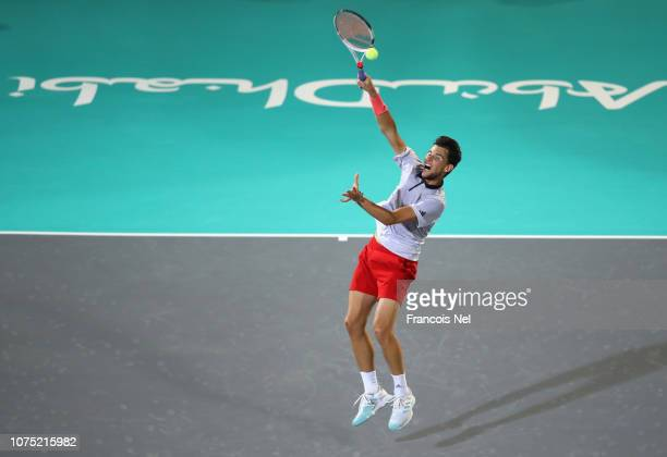Dominic Thiem of Austria in action against Karen Khachanov of Russiaduring his men's singles match on day one of the Mubadala World Tennis...
