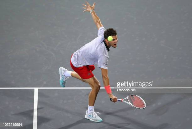 Dominic Thiem of Austria in action against Karen Khachanov of Russia during his men's singles match on day one of the Mubadala World Tennis...