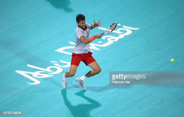 Dominic Thiem of Austria in action against Keren Khachanov of Russia during his men's singles match on day one of the Mubadala World Tennis...