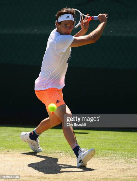 Dominic Thiem of Austria in action during a practice session ahead of the Wimbledon Lawn Tennis Championships at the All England Lawn Tennis and...