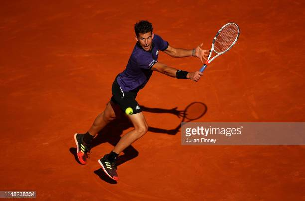 Dominic Thiem of Austria in action in his match against Roger Federer of Switzerland during day seven of the Mutua Madrid Open at La Caja Magica on...