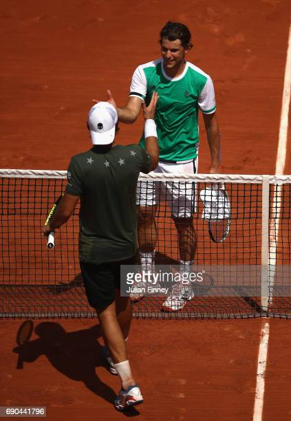 Dominic Thiem of Austria is congratulated on victory in the mens singles second round match by Simone Bolleli of Italy on day four of the 2017 French...