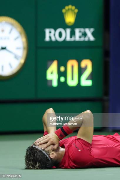 Dominic Thiem of Austria lays down in celebration after winning championship point after a tie-break during his Men's Singles final match against and...