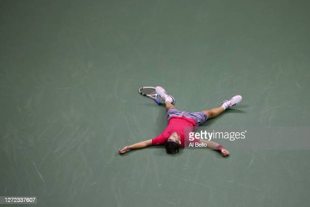 Dominic Thiem of Austria lays down in celebration after winning championship point after a tiebreak during his Men's Singles final match against and...