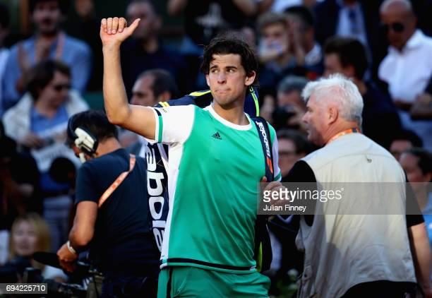 Dominic Thiem of Austria leaves the court following defeat in the mens singles semifinal match against Rafael Nadal of Spain on day thirteen of the...