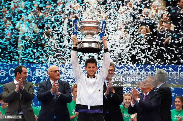 Dominic Thiem of Austria lifts the trophy after defeating Daniil Medvedev of Russia during the final match during day seven of the Barcelona Open...