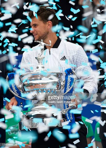 Dominic Thiem of Austria lifts the trophy after defeating Daniil Medvedev of Russia during his Men's round of final match on day seven of the...
