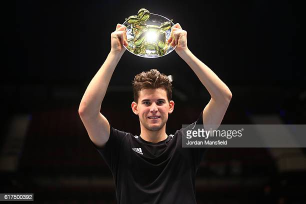 Dominic Thiem of Austria lifts the trophy after victory in his match against Andy Murray of Great Britain during Tie Break Tens at Wiener Stadthalle...