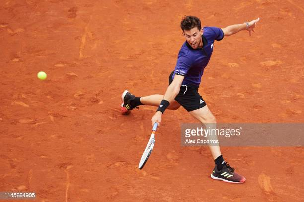 Dominic Thiem of Austria plays a backhand against Daniil Medvedev of Russia during the final match during day seven of the Barcelona Open Banc...
