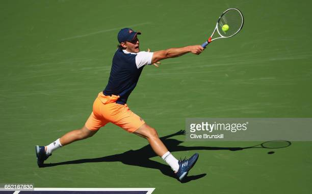 Dominic Thiem of Austria plays a backhand against Jeremy Chardy of France in their second round match during day six of the BNP Paribas Open at...