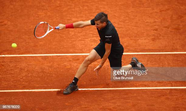 Dominic Thiem of Austria plays a backhand against Kevin Anderson of South Africa in their semi final during day eight of the Mutua Madrid Open tennis...