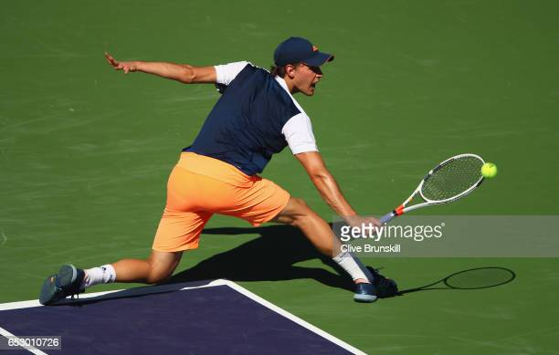 Dominic Thiem of Austria plays a backhand against Mischa Zverev of Germany in their third round match during day eight of the BNP Paribas Open at...